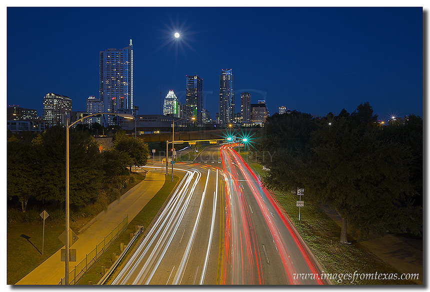 On an October evening in central Texas, traffic goes home from downtown Austin along Casar Chaves. This image of the Austin skyline was captured from Lamar Blvd overlooking the busy Austin street. In the distance, the Austin icons - the Frost Bank Tower and the Austonian, rise over the cityscape.