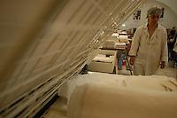 """Artigiani a San Lorenzo , quartiere storico di Roma. Craftsmen in San Lorenzo, historic district of Rome. .""""Photographs & Memories"""". Laboratorio di conservazione e restauro di libri antichi e fotografie gestito da tre..""""Photographs & Memories."""" Laboratory for conservation and restoration of old books and photographs run by three women......."""