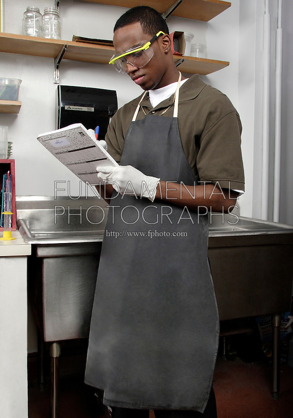 STUDENT WEARING LABORATORY APRON<br />