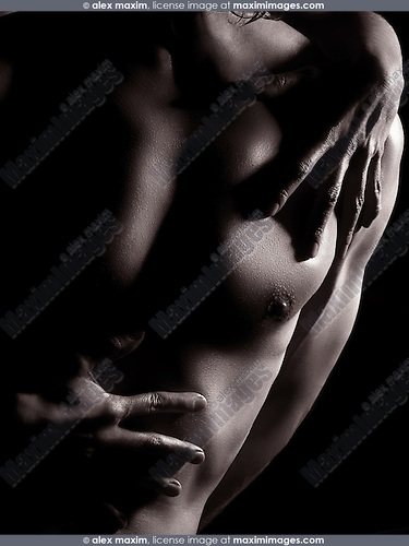 Woman hands on nude man chest, sensual black and white body parts closeup