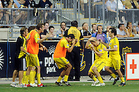 Steven Lenhart (32) of the Columbus Crew celebrates scoring with teammates during a Major League Soccer (MLS) match against the Philadelphia Union at PPL Park in Chester, PA, on August 05, 2010.