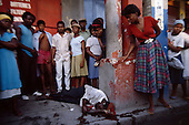 Port-au-Prince, Haiti.November 26, 1987..The man found dead after a night of violence. The ton-ton-macoutes are suspected of creating the violence prior to elections being held on November 29th, the first attempt at a democratic election in Haiti. It was unsuccessful as 34 people were killed at a polling station and elections were moved up to February 1988...Leslie François Manigat won the election with many political parties boycotting. He had military backing but once in office he sought greater control over the military in an effort, to fight corruption. Manigat's government was overthrown by General Henri Namphy within months.