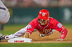 22 August 2015: Washington Nationals infielder Danny Espinosa dives safely back to first during a game against the Milwaukee Brewers at Nationals Park in Washington, DC. The Nationals defeated the Brewers 6-1 in the second game of their 3-game weekend series. Mandatory Credit: Ed Wolfstein Photo *** RAW (NEF) Image File Available ***