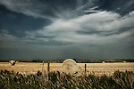 Country scene in USA with hay bales under a dramatic sky