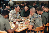 United States President Ronald Reagan has lunch with military personnel at Camp David on Saturday, May 23, 1987.  At the President's table were: (clockwise from left) Yeoman 2nd Class R.L. Murry of Detroit, Michigan; Corporal T.D. Reece of Tuscaloosa, Alabama; President Reagan; Utilitiesman 1st Class J.W. Adams of Langley, South Carolina; Staff Sergeant M.A. Rhoades of Gulfport, Mississippi; Lance Corporal S.P. Ayers of Waenette, Oklahoma; Builder third Class C.R. Bush of Johnstown, Pennsylvania; and Corporal J.C. Grigsby of London, Kentucky.  The President spent the week-end at Camp David after returning from Memorial Services for the crewmen killed aboard the USS Stark..Mandatory Credit: Pete Souza - White House via CNP
