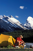 CANADA, ALBERTA, KANANASKIS, MAY 2002. A hiker enjoys the sunset while camping at Mud Lake.   The Kananaskis Country provincial park is home to Canada's most beautiful nature and wildlife. It has also escaped the mass tourism as in Banff National Park. Photo by Frits Meyst/Adventure4ever.com