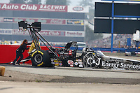 Feb 9, 2014; Pomona, CA, USA; NHRA top fuel dragster driver Bob Vandergriff Jr gets pushed off the track by the Safety Safari during the Winternationals at Auto Club Raceway at Pomona. Mandatory Credit: Mark J. Rebilas-