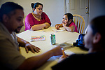 From left, Dennis and Sophia Sawyer help their children, Frances and Daniel with their homework January 27, 2010 in Sacramento, Calif. The Sawyer family receives $540/month in CalWORKs assistance from the state of California. Dennis is currently unable to work while recovering from cancer, and Sophia hasn't been able to find work. Gov. Arnold Schwarzenegger has proposed eliminating the CalWORKs program in an effort to balance the state's budget. CREDIT: Max Whittaker for The Wall Street Journal.CABUDGET