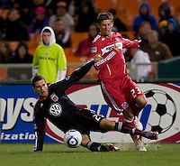 Krzysztof Krol (23) of the Chicago Fire has the ball cleared away from him by Santino Quaranta (25) of DC United at RFK Stadium in Washington, DC.  The Chicago Fire defeated DC United, 2-0.