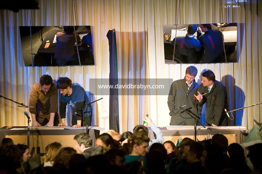 21 March 2006 - New York City, NY - Architects Amador Pons (L) and Matthew Grzywinski (2L) from the firm Grzywinski-Pons and Daniel Colvard (2R) and Eric Hofmann (R) from the firm Arquitectonica race to design and build a model as they compete in Architecture Duel, a timed architectural competition organised by the creative group, the LVHRD Foundation, in New York City, USA, 21 March 2006. The duel was won by the 2-person firm Grzywinski-Pons. Arquitectonica is a +400 person firm with offices around the world.