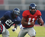 Ole Miss' Barry Brunetti (11) runs upfield during a team scrimmage at Vaught-Hemingway Stadium in Oxford, Miss. on Saturday, August 20, 2011.