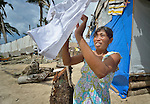 A man hangs laundry in Bacubac, a neighborhood in Basey in the Philippines province of Samar that was hit hard by Typhoon Haiyan in November 2013. The storm was known locally as Yolanda. The ACT Alliance has been providing a variety of forms of assistance to survivors here.