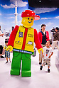 June 14, 2012, Tokyo, Japan - Kids play with a giant Lego man during a press preview event at the LEGOLAND Discovery Center Tokyo. The LEGOLAND Discovery Center contains over 3 million LEGO bricks in-house, a 4D movie theater, iconic city land marks of Tokyo all made of LEGO, and a interactive laser ride. The discovery center will open to the general public on June 15, 2012. (Photo by Christopher Jue/AFLO)