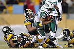 PITTSBURGH, PA - JANUARY 23: Brad Smith #16 of the New York Jets is tackled by Keyaron Fox #57 and Anthony Madison #37 of the Pittsburgh Steelers in the AFC Championship Playoff Game at Heinz Field on January 23, 2011 in Pittsburgh, Pennsylvania(Photo by: Rob Tringali) *** Local Caption *** Brad Smith;Keyaron Fox;Anthony Madison