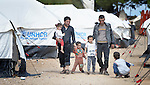 Syrians walk through a camp for refugees who have arrived on the Greek island of Chios after crossing the Aegean Sea in small boats from Turkey. They are registered and provided with food and shelter in a reception center built with support from International Orthodox Christian Charities, a member of the ACT Alliance. Hundreds of thousands of refugees and migrants have passed through Greece in 2015 on their way to western Europe.