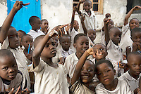 Children in their classroom in Mont Goma primary school, which has been taken over by displaced people...