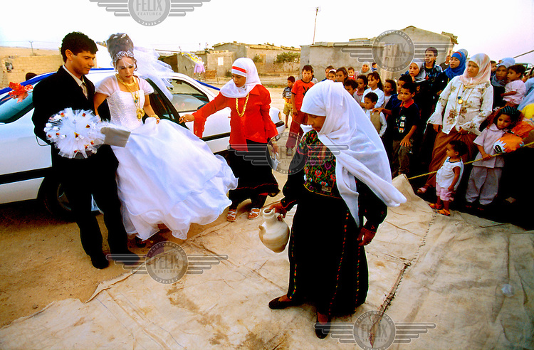 A newly married couple during their wedding party in the unrecognised Bedouin village of Abu-Ajaj..
