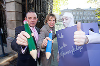 NO REPRO FEE. 18/10/2011. Cross partyTDs  to put aside party differences for Alzheimers. Cross party elected officials will join forces with a giant purple post it character outside the gates of Dail Eireann to remind elected officials to sign up to the Alzheimer Pledge to bring in a National Dementia Strategy for Ireland. Pictured are TD's Ivana Batchik and Jerry Buttimer TD Fine Gael. Picture James Horan/Collins Photos