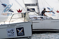 Bowman Nick Blackman spots breeze for Adam Minoprio od day 3 of Match Race Germany 2010. World Match Racing Tour. Langenargen, Germany. 22 May 2010. Photo: Gareth Cooke/Subzero Images/WMRT