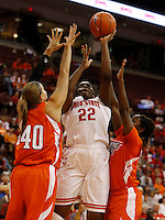 Ohio State Buckeyes center Darryce Moore (22) drives by Bowling Green Falcons forward Jill Stein (40) andvBowling Green Falcons guard Jasmine Matthews (1) in the second half at Value City Arena in Columbus Nov. 24, 2013.