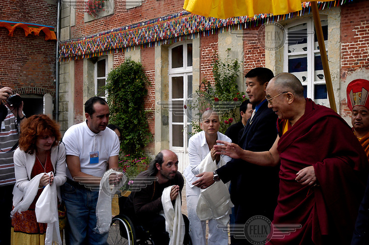 His Holiness the Dalai Lama departing from the Vajradhara Ling Buddhist Temple during the visit of His Holiness to France. The Dalai Lama blessed a project to build a Temple for Peace at the centre and gave a speech to hundreds of guests.
