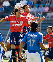 Veracruz Tiburones Rojos defenders Pablo Quatrocchi (L) and Miguel Acosta head the ball during an attack from Cruz Azul in the Azul Stadium in Mexico City, April 8, 2006, Cruz Azul forward Alejandro Corona (17) and Veracruz defender Joel Sanchez (far right) look at the scene. Cruz Azul won 3-0 to Veracruz... Photo by © Javier Rodriguez