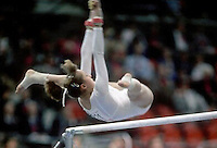 Ecaterina Szabo of Romania performs release to recatch on uneven bars at 1985 World Championships in women's artistic gymnastics at Montreal, Canada in mid-November, 1985.  Photo by Tom Theobald.