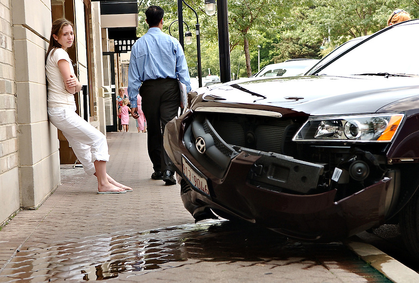 A teenage driver drove her mother's car into the side of a building near the Eddie Bauer store on Jefferson St. in Downtown Naperville Friday.