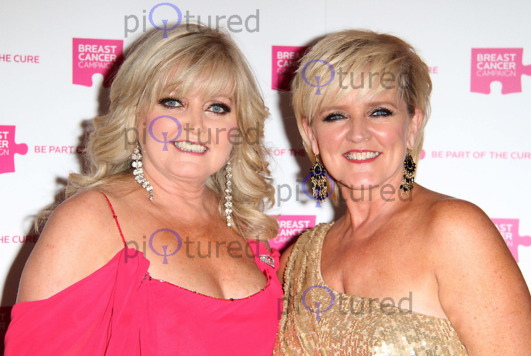 Linda Nolan; Bernie Nolan The Pink Ribbon Ball, Dorchester Hotel, London, UK. 08 October 2011. Contact: Rich@Piqtured.com +44(0)7941 079620 (Picture by Richard Goldschmidt)