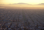 &copy; Mark Henley / Panos Pictures..Mexico City, MEXICO...Aerial view of urban sprawl in the Nezahualeuyotl area of the city, with the remains of a once-great lake in the distance.