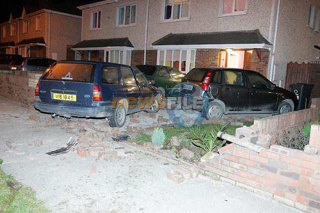 The Hylands an Eu National driving a Northern Ireland Car ploughes througn two walls and crashes into two parked cars ramminf then into the front wall of the owners house late on Saturday night, the Drogheda Fire and rescue service was called to the scene as the driver had to be removed to hospital by Ambulance..Photo NEWSFILE/FRAN CAFFREY..(Photo credit should read FRAN CAFFREY/NEWSFILE)...This Picture has been sent you under the condtions enclosed by:.Newsfile Ltd..the Studio,.Millmount Abbey,.Drogheda,.Co Meath..Ireland..Tel: +353(0)41-9871240.Fax: +353(0)41-9871260.GSM: +353(0)86-2500958.email: pictures@newsfile.ie.www.newsfile.ie.FTP: 193.120.102.198..This picture is from Fran Caffrey@newsfile.ie