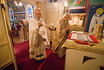 Liturgy service at St. Sava Orthodox Church, Jackson, Calif...Father Stephen Tumbas spreads incense as Very Reverend Stavrofor Miladin Garich prays at the altar during the religious service.