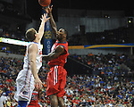 Ole Miss' Murphy Holloway (31) vs. Florida's Erik Murphy (33) in the SEC championship game at Bridgestone Arena in Nashville, Tenn. on Sunday, March 17, 2013.
