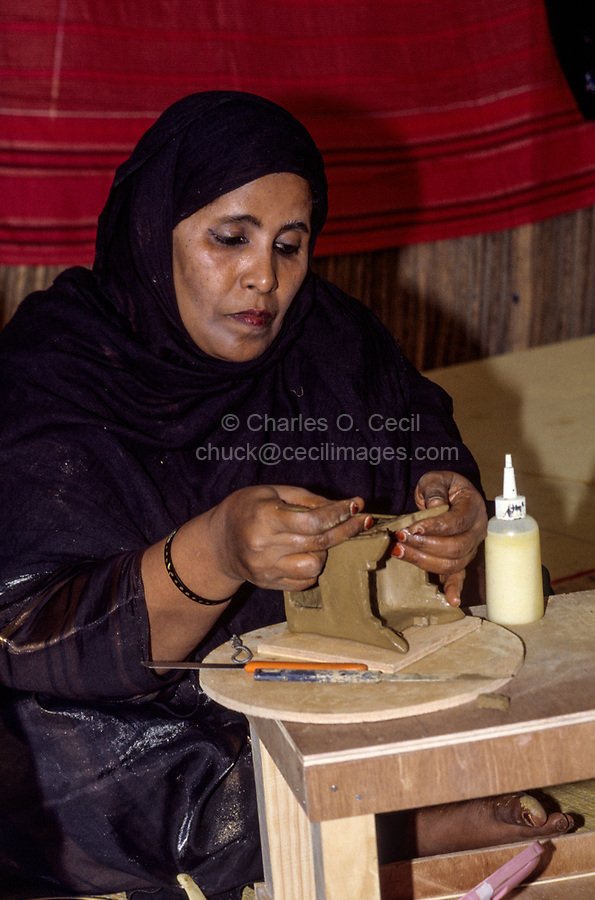 Oman.  Woman from Mirbat, Dhofar, Making Ceramic Incense Burner.