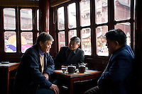 Men drinking tea in the Huxinting Teahouse, Yu Garden Bazaar Market, Shanghai, China