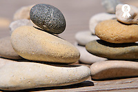 Stack of pebbles on wooden floor (Licence this image exclusively with Getty: http://www.gettyimages.com/detail/81865733 )