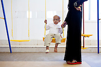 A young cancer patient plays on a swingset at the new Basrah Children's Hosptial on Saturday, October 23, 2010 in Basrah, Iraq.