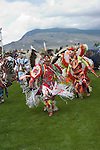 WY: Wyoming, Cody: Dancing at Plains Indian June Powwow...Photo #: yellow552..Photo copyright Lee Foster, 510/549-2202, lee@fostertravel.com, www.fostertravel.com..