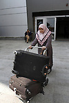 A Palestinian woman crosses into Gaza through the Rafah border crossing between Egypt and southern Gaza Strip on November 30, 2014. Egyptian authorities reopened this week the Rafah crossing with Gaza for two days this week to allow Gaza residents stranded in Egypt to return home. Rafah crossing is the only access point to the Palestinian territory not controlled by Israel, for the first time since its closure in late October after a bombing in the Sinai Peninsula. Photo by Abed Rahim Khatib