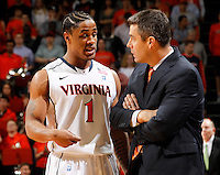 CHARLOTTESVILLE, VA- JANUARY 7: Jontel Evans #1 of the Virginia Cavaliers talks with head coach Tony Bennett of the Virginia Cavaliers during the game against the Miami Hurricanes on January 7, 2012 at the John Paul Jones Arena in Charlottesville, Virginia. Virginia defeated Miami 52-51. (Photo by Andrew Shurtleff/Getty Images) *** Local Caption *** Jontel Evans;Tony Bennett