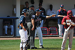 Ole Miss Head Coach Mike Bianco (5) argues a call with home plate umpire Joe Marion (35) at Oxford-University Stadium in Oxford, Miss. on Sunday, March 20, 2011.  (AP Photo/Oxford Eagle, Bruce Newman)