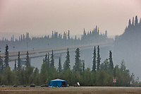 Thick forest fire smoke along the James Dalton highway, bridge crossing the Yukon River, Alaska.