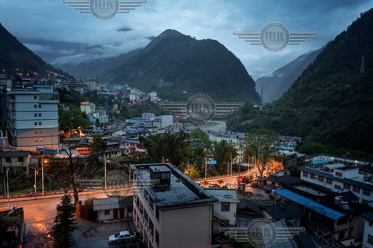 A view at dawn of the Nujiang River as it runs through Gongshan, the largest town in the north of the Nujiang River Valley.