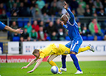 St Johnstone v Hibs...02.10.10  .Derek Riordan is upended by Michael Duberry.Picture by Graeme Hart..Copyright Perthshire Picture Agency.Tel: 01738 623350  Mobile: 07990 594431