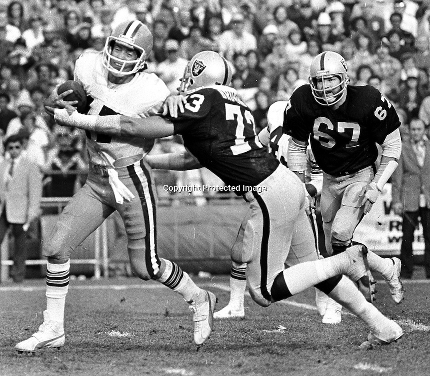 Oakland Raider Dave Browning sacks Cleveland QB Brian Sipe, #67 Pat Toomay. (1979 photo/Ron Riesterer)