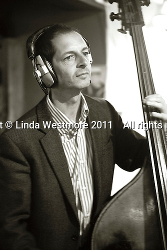 """Gary Holder, musician with the """"Edge of Chaos Orchestra"""" recording at the Blue Coconut Club, Pulborough, West Sussex."""