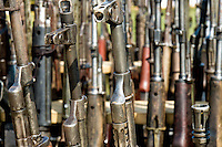 A set of automatic guns that belonged to the demobilized Colombian paramilitary forces (AUC) in a jungle settlement Casibare, Meta Department, Colombia, 10 April 2006.