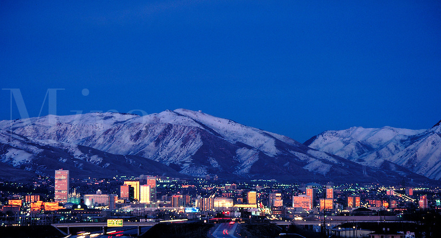 Skyline of Salt Lake City, Utah with snowcovered Wasatch Mountains in the background. cityscape, urban design, night shot. Salt Lake City Utah.