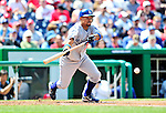 25 April 2010: Los Angeles Dodgers' shortstop Rafael Furcal lays lown a bunt against the Washington Nationals at Nationals Park in Washington, DC. The Nationals shut out the Dodgers 1-0 to take the rubber match of their 3-game series. Mandatory Credit: Ed Wolfstein Photo