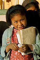 Indian girl going to school in the Andes in Tarapaca Province in Northern Chile.